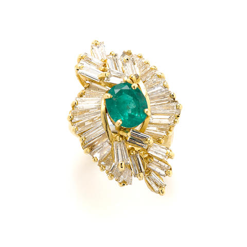 An emerald, diamond and gold cluster ring