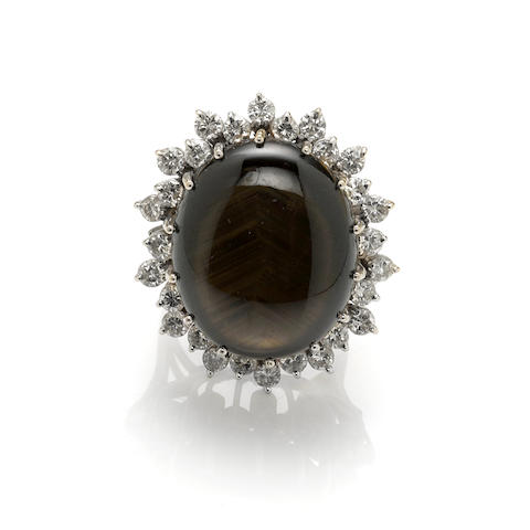 A black star sapphire, diamond and white gold ring