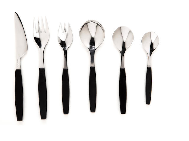 A Georg Jensen stainless steel flatware set: Strata designed by Henning Koeppel 1963