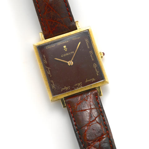 An 18k gold square case Corum wristwatch with original gold plated corum buckle