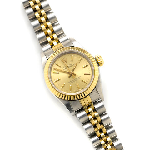 A stainless steel and gold bracelet wristwatch, Rolex with papers and a box