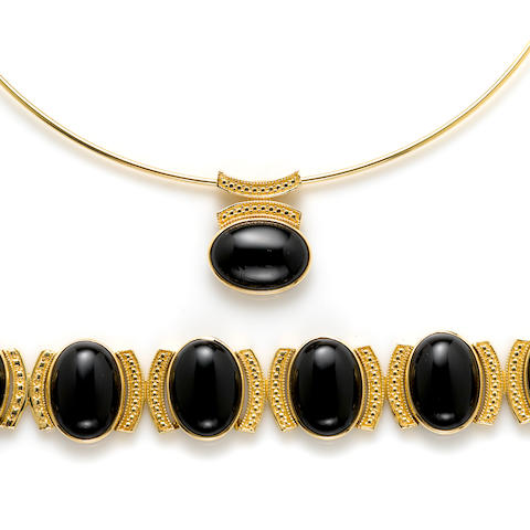 A black onyx and 14k gold necklace collar and bracelet