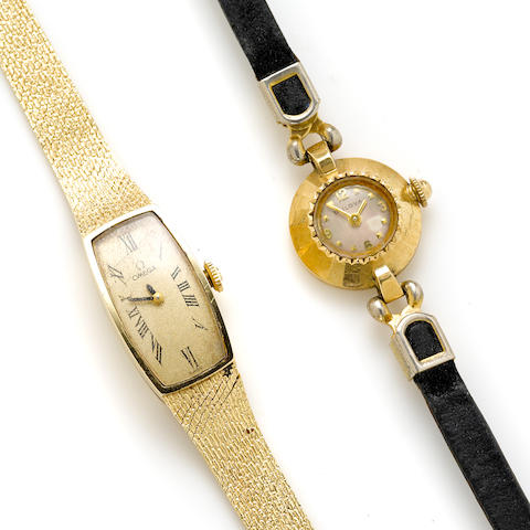 A 14k integral bracelet wristwatch, Omega, together with a 14k gold wristwatch, Bulova, with later leather and metal strap