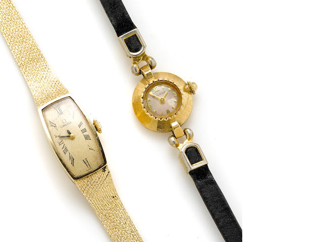 A 14k Omega bracelet wristwatch together with a 14k gold Bulova watch head; together with an Omega box