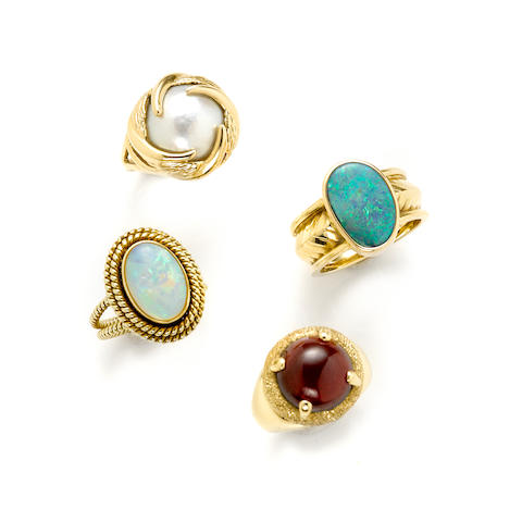 A collection of nine gem-set and 14k gold rings together with a pendant