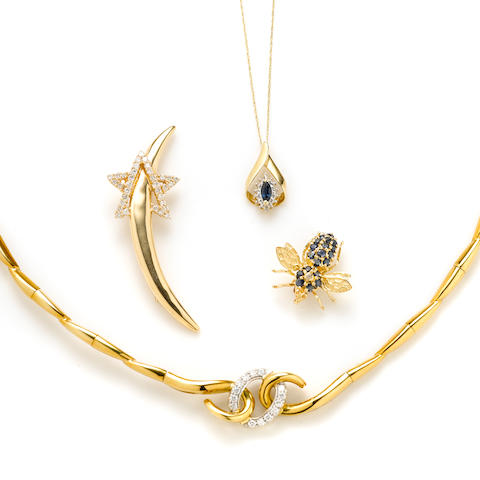 A group of diamond, sapphire and gold jewlery; comprising a necklace, star brooch, pendant with chain, bee brooch