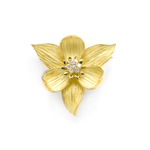 A diamond and 18k gold trillium flower pendant-enhancer/brooch
