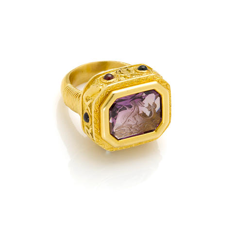 A carved amethyst, gem-set and hi karat gold ring