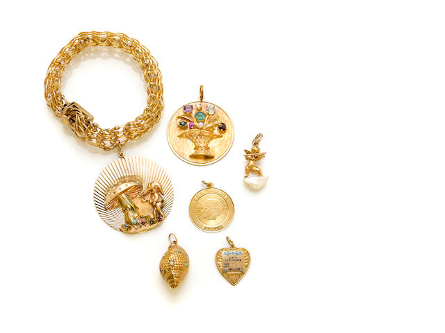 A gem-set and 14k gold charm bracelet