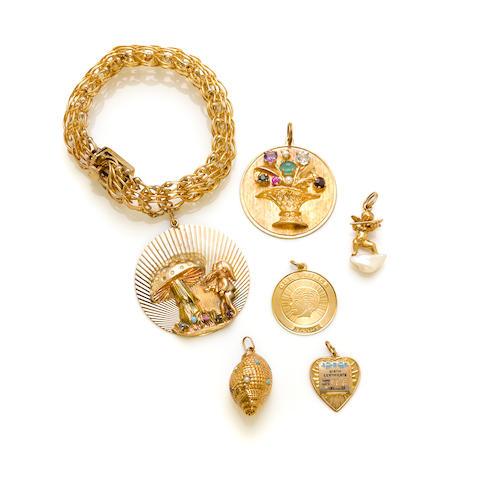 A gem-set and 14k gold charm bracelet
