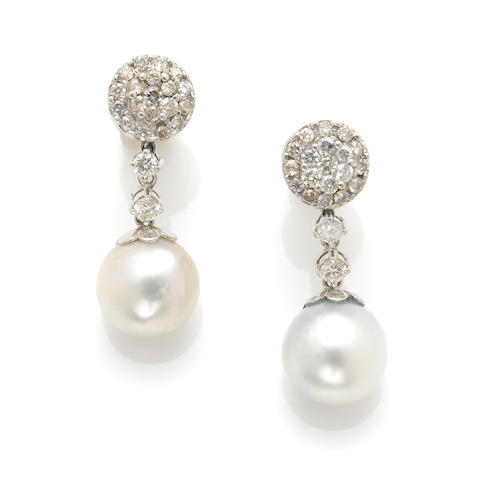 A pair of cultured pearl, diamond and white gold earrings