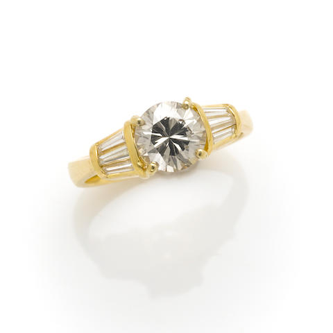 A colored diamond, diamond and 18k gold ring