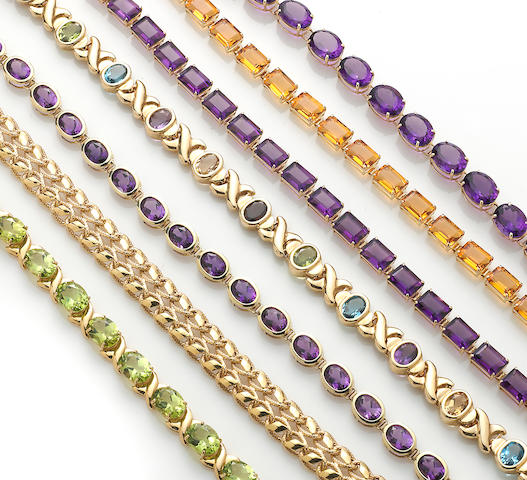 A collection of seven gem-set and 14k gold bracelets