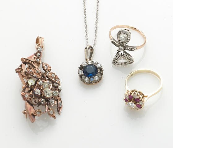 A group of four pieces including two diamond and gem-set rings, a diamond and gem-set pendant and a mine-cut diamond brooch *diamonds missing