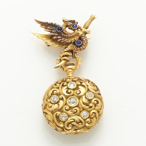A diamond and 18k gold open face pendant watch suspended from a gem-set and 14k gold wyvern brooch