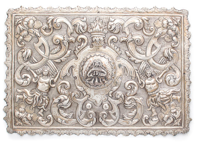 A pair of Latin American silver repousse bible covers, each molded with figures and strapwork, height 8in; width 11 1/2in, possibly plated