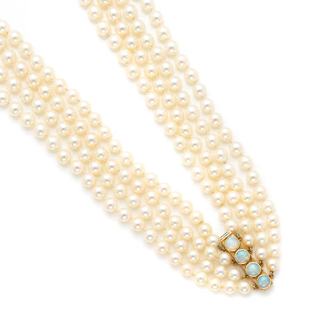 A four strand cultured pearl necklace with opal clasp