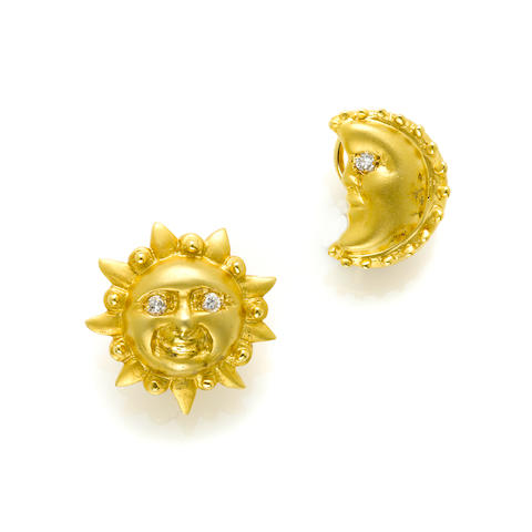 "A pair of diamond and 14k gold ""sun and moon"" earrings"