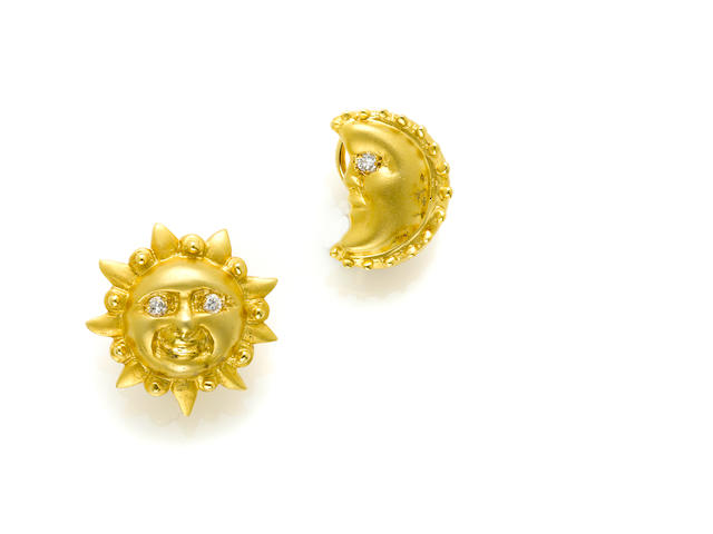 A pair of 14 karat gold and diamond 'sun and moon' ear clips