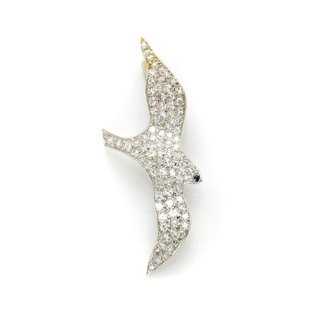 A pave set round brilliant cut diamond and white gold 'bird' pendant with sapphire eye