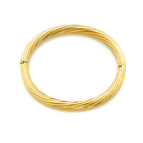 An 18k gold twisted flute bangle bracelet