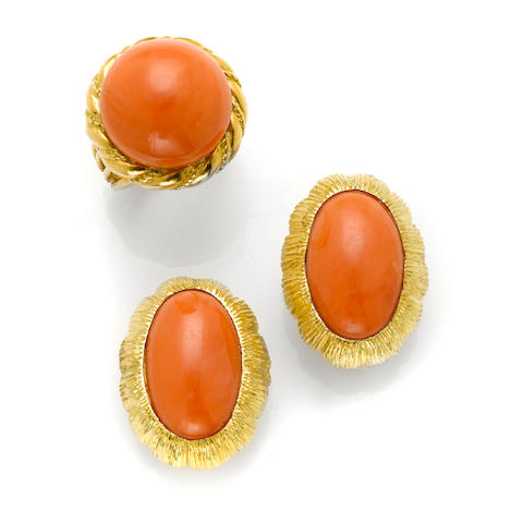 A pair of coral and 14k gold earclips together with a coral and 18k gold ring