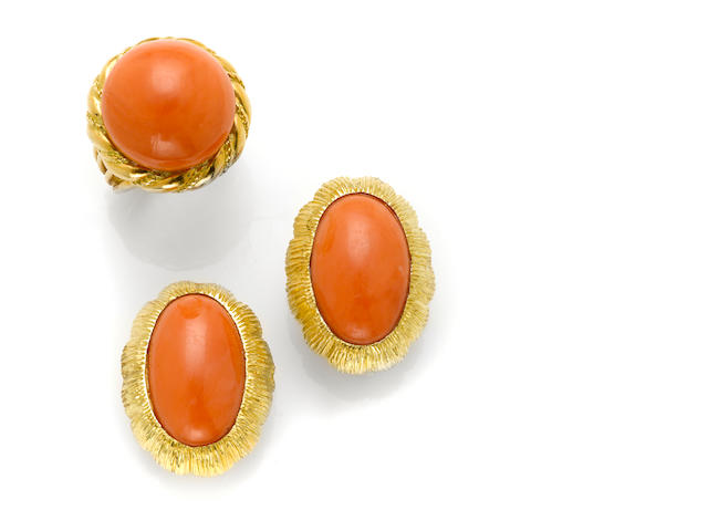 A pair of coral and 14 karat gold ear clips together with A coral button and 18 karat gold ring