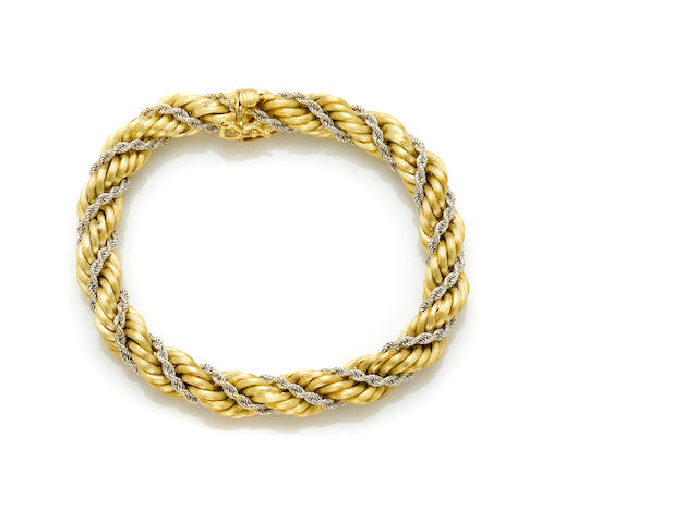 An 18 karat gold rope bracelet with white gold rope wrap, Italy weight 26g