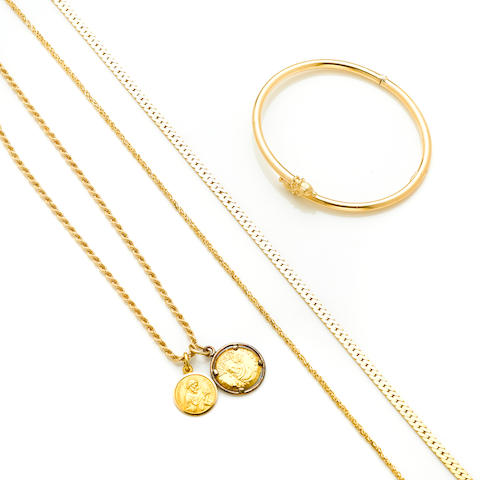 A 14 karat gold by-pass bangle weight 9.4g; A 14 karat gold serpentine link chain weight 19.8g; length 18in; A 14 karat gold tinsel link chain weight 7.8g; length 18in; A 14 karat gold rope chain with two 18 karat gold medallions One set in silver bezel. length 20in