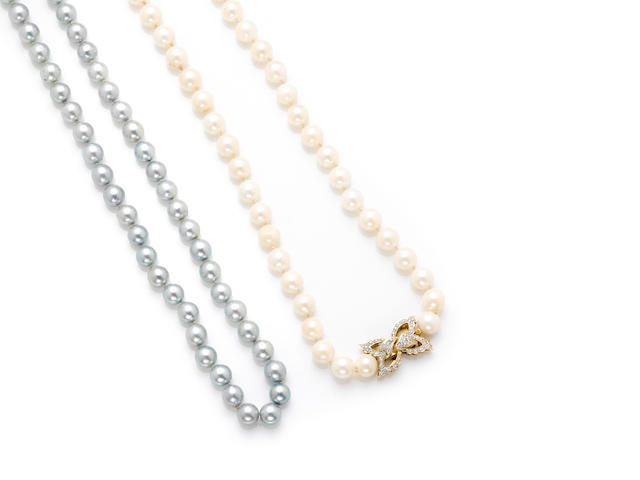 A blue/grey cultured pearl necklace Together with a white cultured pearl necklace with 14 karat gold and diamond clasp. length of first 32in; length of second 36in
