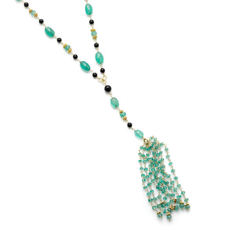 An emerald, black onyx bead and 18k gold tassel necklace