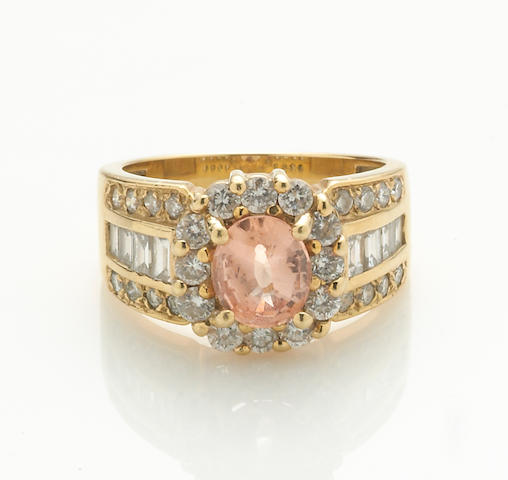 A peach sapphire, diamond and 18k gold ring