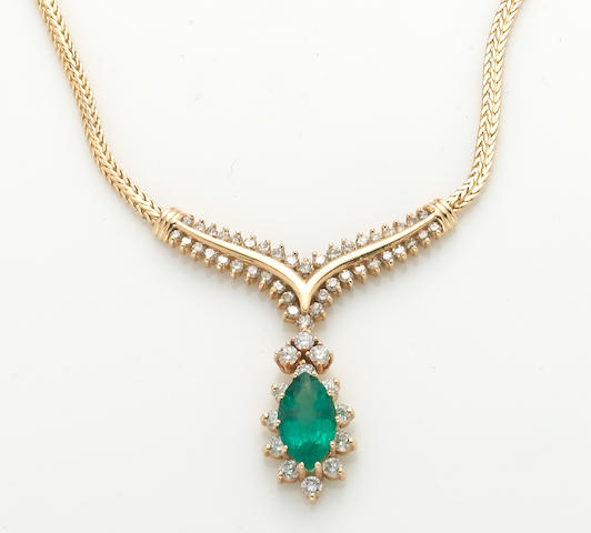 A 3.21ct emerald and 2.65ct diamond necklace in 14k, 17.6g