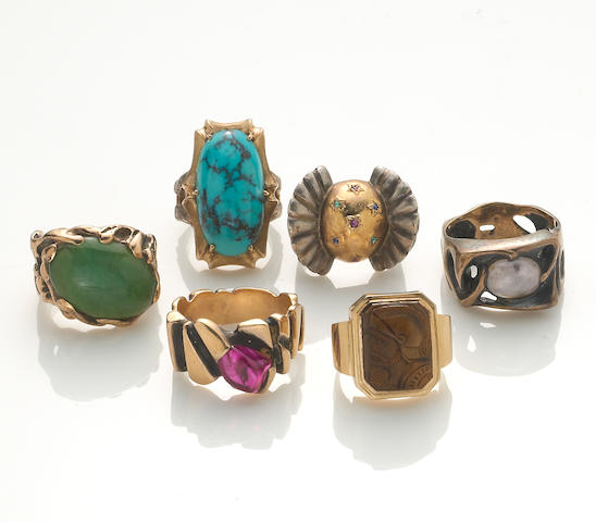 A collection of six hardstone, gem-set, silver and 14k gold rings