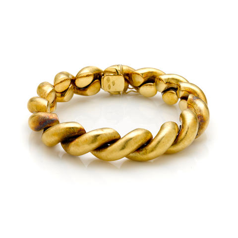 An 18k yellow gold satin finish bangle bracelet