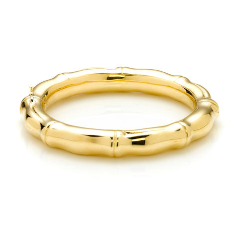 An 18k yellow gold bamboo style satin finish bangle bracelet (obvious wear to bangle)