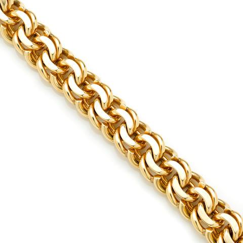 A 14k gold wide spiral link bracelet