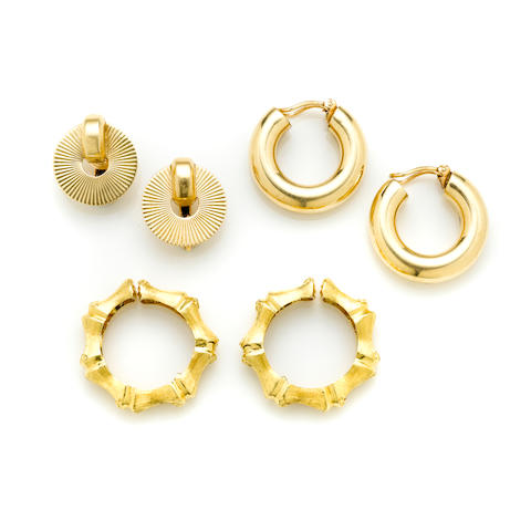 A group of two pairs of 14k gold earclips together with A pair of 18k gold bamboo motif earclips