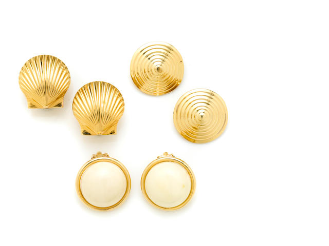 A group of three pairs of gold and coral earclips
