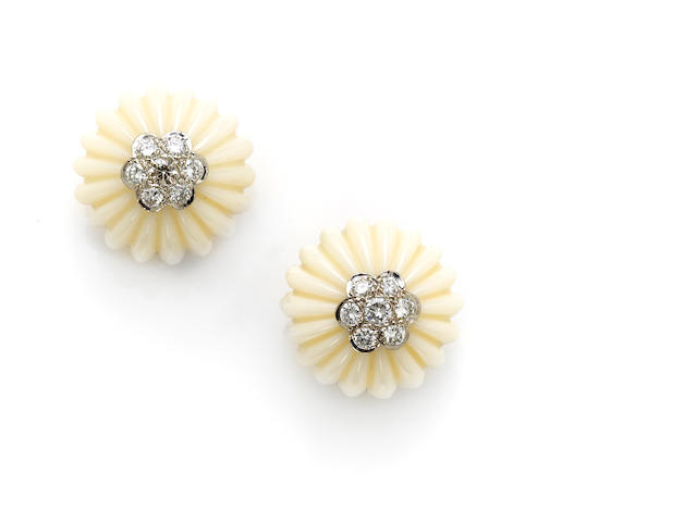 A pair of white coral, diamond, platinum and 18k gold earclips