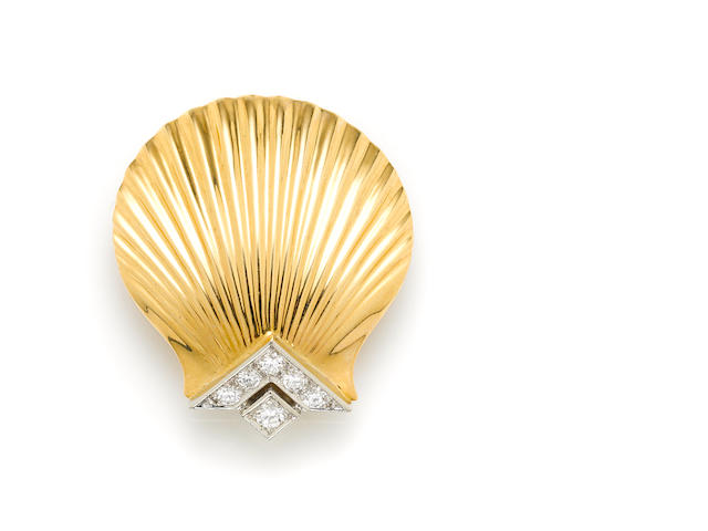 A diamond, 14k gold and platinum shell brooch