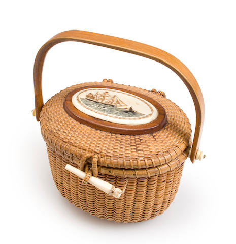 An Oval Nantucket Friendship Basket with Lid depicting a ship passing a lighthouse