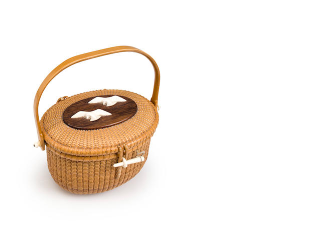An Oval Nantucket Friendship Basket with Hinged Lid depicting a pair of gulls