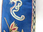 A group of four embroidered silk accessories Late Qing/Republic period