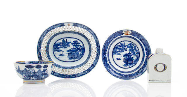 A Chinese Export reticulated blue and white Nanking platter together with an Imperial Nanking waste bowl, a Chinese Export Nanking soup bowl and a Chinese Export tea caddy