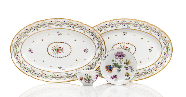 A pair of Paris porcelain oval platters and a Meissen porcelain tea bowl and matching saucer