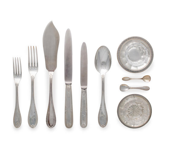 A Italian silver flatware service for twelve comprising twelve dinner knives, twelve luncheon knives, twelve dinner forks, twelve luncheon forks, twelve table spoons, four glass salts with fitted silver holders, four salt spoons and one master cheese knife together with fitted canteen, 73 pieces total