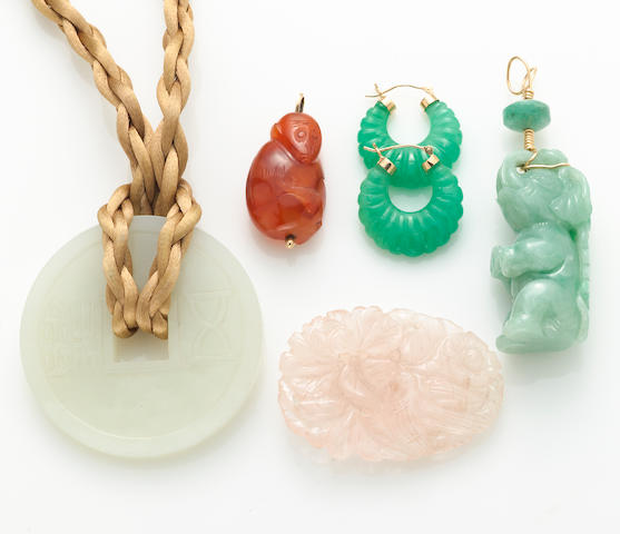 A collection of carved hardstone, cord, metal and 14k gold jewelry
