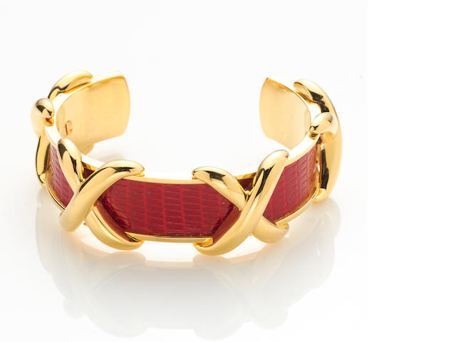 A red lizard and gold-plate cuff bracelet together with silk scarf, Hermès