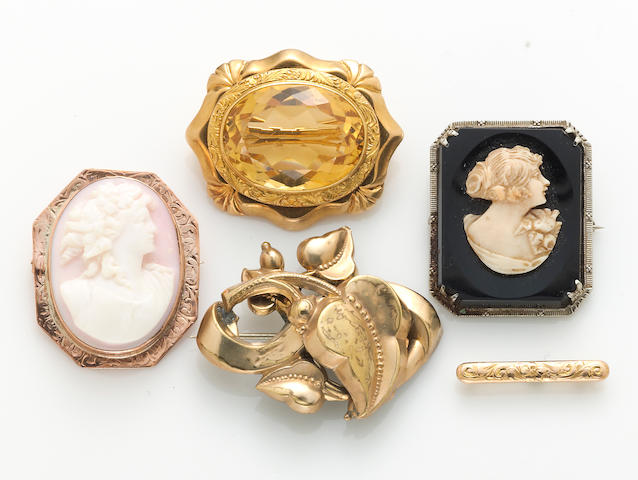 A collection of five citrine, shell cameo, composite bone and hardstone cameo, 10k and 14k gold brooches